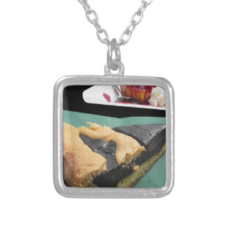 Piece of chocolate cake and cheesecake silver plated necklace