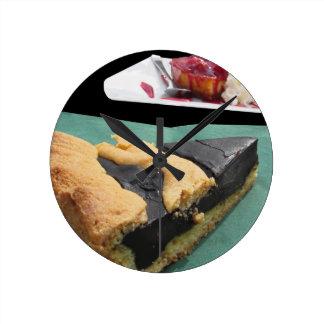 Piece of chocolate cake and cheesecake wallclocks