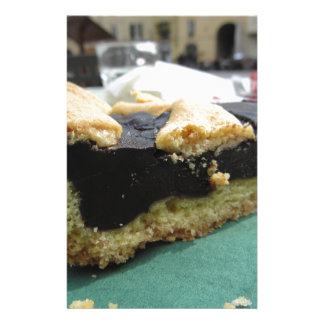 Piece of chocolate cake on green paper napkin