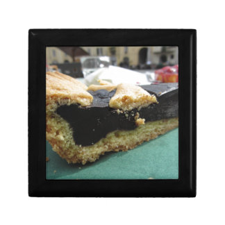 Piece of chocolate cake on green paper napkin gift box