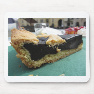 Piece of chocolate cake on green paper napkin mouse pad
