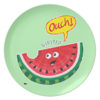 Piece of watermelon expressing pain after a bite plate