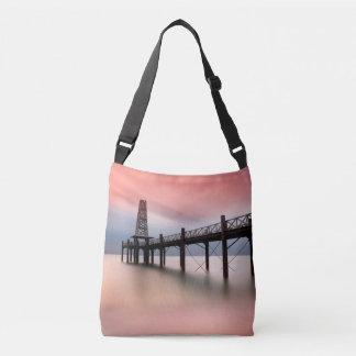 Pier at sunset crossbody bag