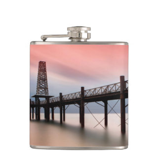 Pier at sunset hip flask