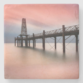 Pier at sunset stone coaster