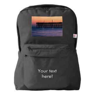 Pier beach sunset backpack