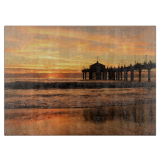 Pier beach sunset cutting board