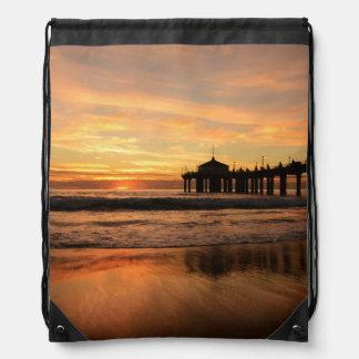 Pier beach sunset drawstring bag