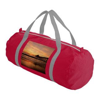 Pier beach sunset gym bag