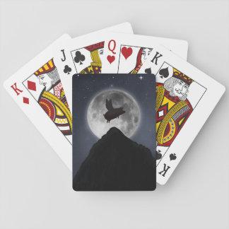 pig flying past full moon poker deck