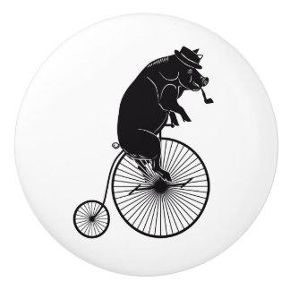 Pig or Hog Riding a Penny Farthing Bike Ceramic Knob