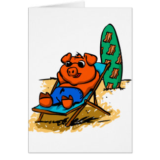 Pig sunbathing on the beach card