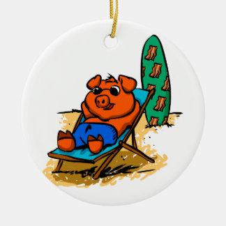 Pig sunbathing on the beach ceramic ornament