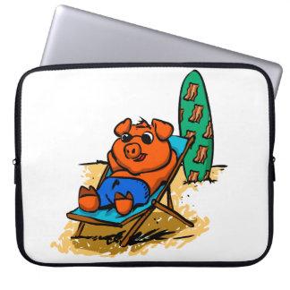 Pig sunbathing on the beach laptop sleeve