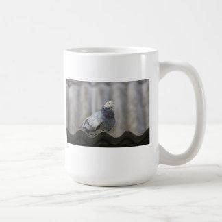 Pigeon on the roof. coffee mug