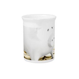Piggy bank and coins pitcher