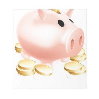 Piggy bank and gold coins notepads