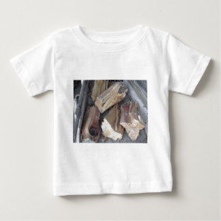 Pile of irregularly chopped firewood on old cart baby T-Shirt