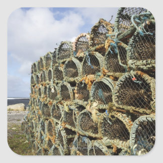 pile of lobster crab pots on Irish shoreline Square Sticker