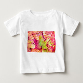 Pile of maple leaves in fall colors baby T-Shirt