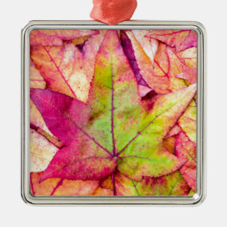 Pile of maple leaves in fall colors Silver-Colored square decoration