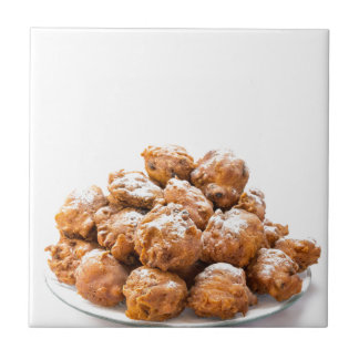 Pile of sugared oliebollen or fried fritters ceramic tile
