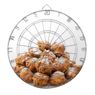 Pile of sugared oliebollen or fried fritters dartboard