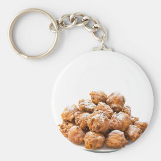 Pile of sugared oliebollen or fried fritters key ring