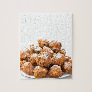 Pile of sugared oliebollen or fried fritters puzzle