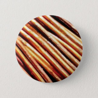 piles of copper pipes 6 cm round badge