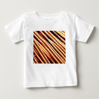 piles of copper pipes baby T-Shirt