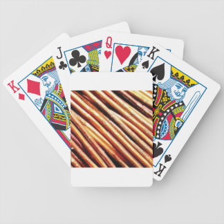 piles of copper pipes bicycle playing cards