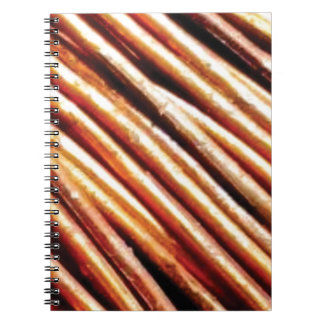 piles of copper pipes notebooks