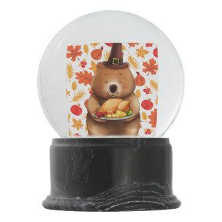 pilgram bear with festive background snow globe