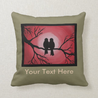 Pillow of love birds on a tree branch.