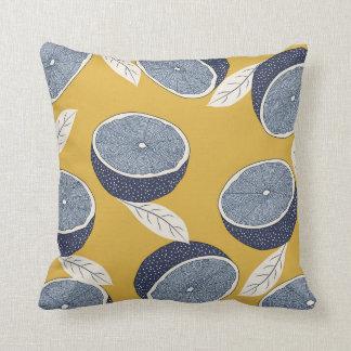 Pillow with lemon pattern.