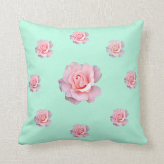Pillow with pastel color roses.