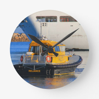 Pilot boat and cruise ship round clock