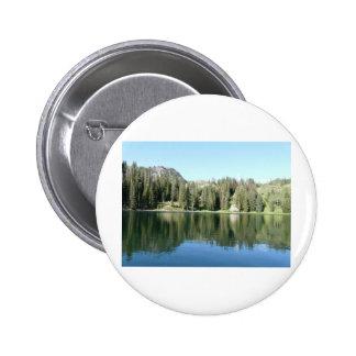 pine tree mirror on lake button