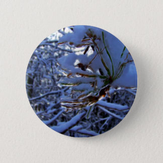 Pine tree with snow and light reflecting on a need 6 cm round badge