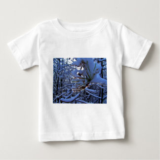 Pine tree with snow and light reflecting on a need baby T-Shirt