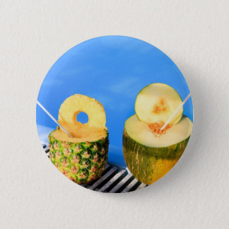 Pineapple and melon fruit with straws at pool 6 cm round badge