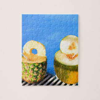 Pineapple and melon fruit with straws at pool jigsaw puzzle