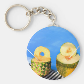 Pineapple and melon fruit with straws at pool key ring