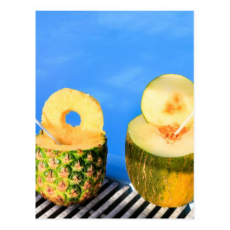Pineapple and melon fruit with straws at pool postcard