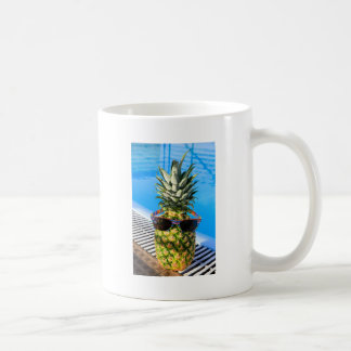 Pineapple wearing sunglasses at swimming pool coffee mug