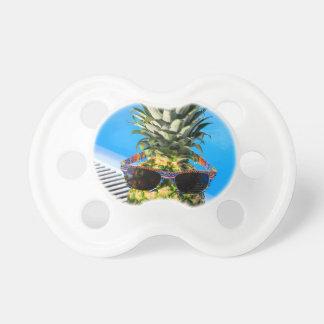 Pineapple wearing sunglasses at swimming pool dummy