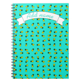 Pineapples on Blue background. Notebooks
