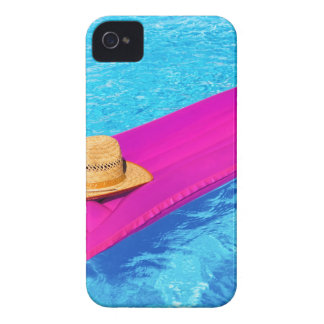 Pink air mattrass with hat in swimming pool iPhone 4 covers