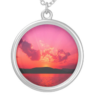 pink and red sunset on horizon necklaces